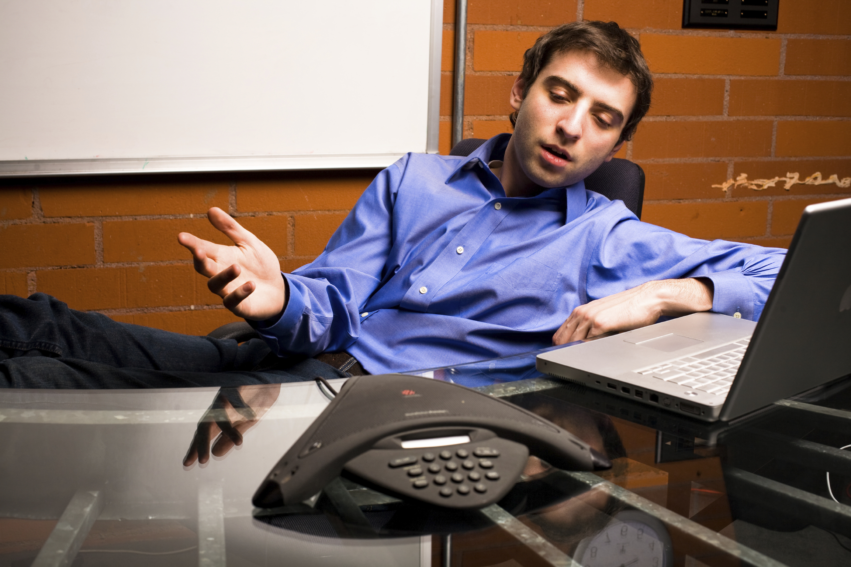 istock_guy-on-conference-call-000005505122medium1